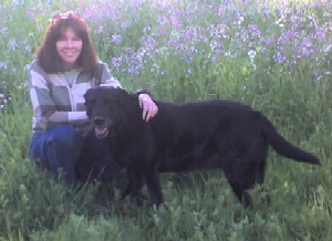 Mary Pope-Handy and the Handy family dog, Bella, at Belgatos Park in Los Gatos
