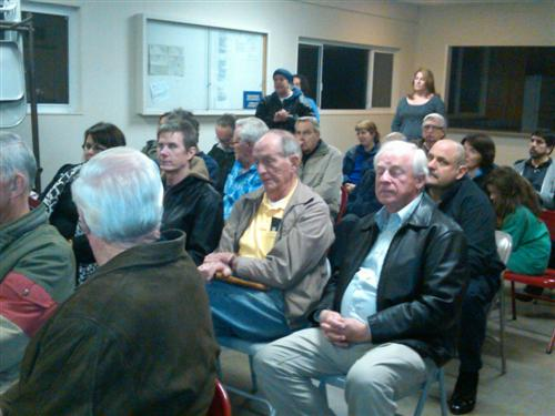 Neighbors listen to questions and commentary on the explosion at Westhill and Belblossom on March 5, 2012