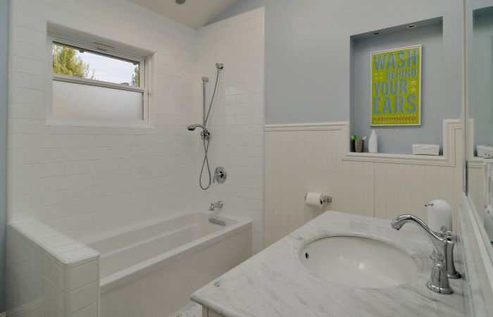 023 Hall Bathroom 700x450 - Exquisitely remodeled home & yard for sale in Belwood - 127 Belhaven Drive